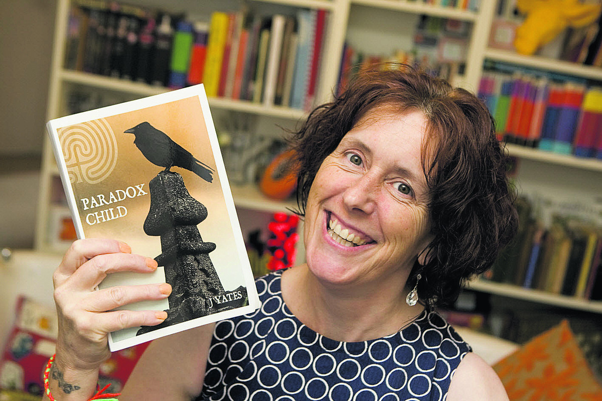 Jane Yates with her first book, Paradox Child