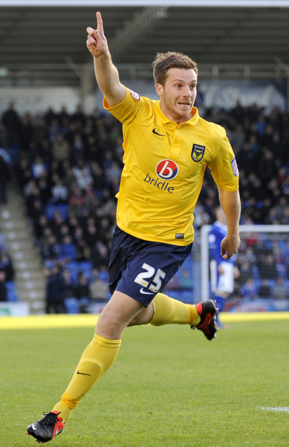 Johnny Mullins, pictured   celebrating his goal at Chesterfield in November last year, is returning for a second spell at Oxford United