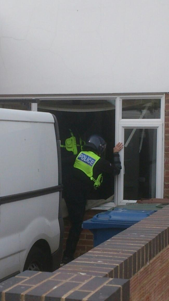 RAID: Police force their way into a property in Kidlington