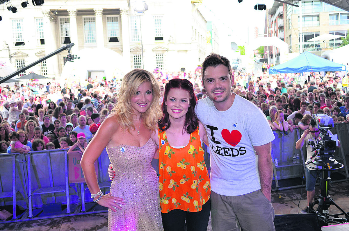 Lindsey Russell, centre, with current Blue Peter hosts Barney Harwood and Helen Skelton