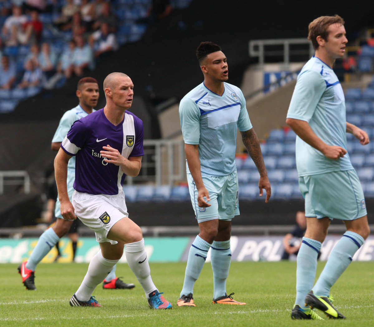 United striker James Constable (left) watches as his shot flies into the back of the Coventry City net