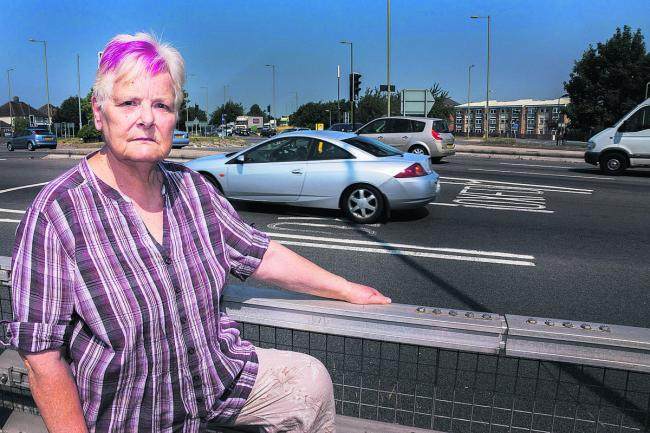 'LET THERE BE LIGHTS': Barbara Naylor by the Green Road roundabout
