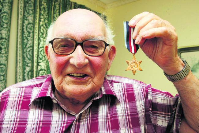 Stan Cooper with his medal