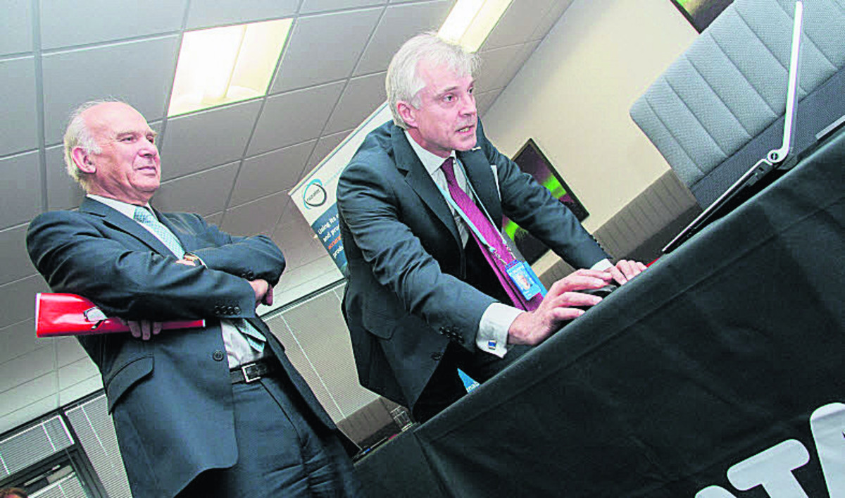 Vince Cable, left, with Peter Lilley, of Igeolise, at the Catapult centre in Harwell