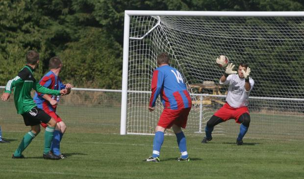 Oxford Mail: Zubry's Tomasz Serednicki (in green) watches as his shot is saved by Oxford's Darren Kinch