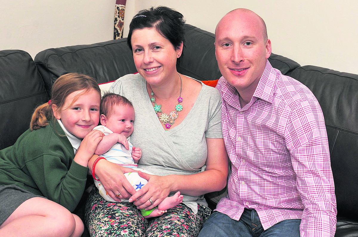 NEW LIFE: Amber's parents James Phillpott and Fleur Tinson with their daughter Daisy and baby son Barney