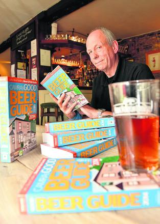 Real ale enthusiasts drink to Good Pub Guide's new edition