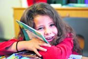 ENTHUSED: Aaliyah Flynn, six, from Cutteslowe Primary School, Oxford, where pupils have been reading Project X Code books
