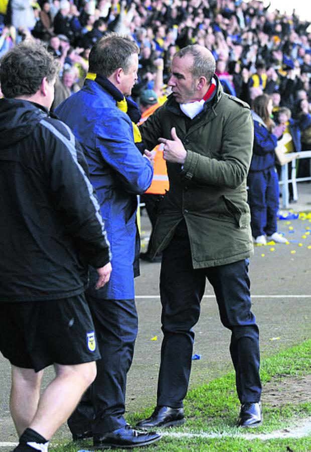 Oxford Mail: Paolo Di Canio has words with Oxford United boss Chris Wilder at the Kassam Stadium in March 2012 during his spell at Swindon