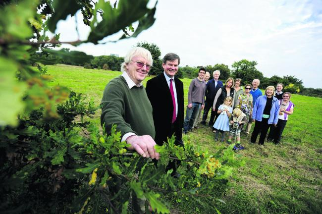Andrew Carter and other members of the Friends of Warneford Meadow with trust chief executive Stuart Bell, right
