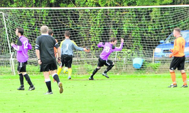 Oxford Mail: Bampton United's Conor Kelly (No 10) turns to celebrate his goal as his side beat Bampton Town 2-1 in the second round of the Fred Ford Cup