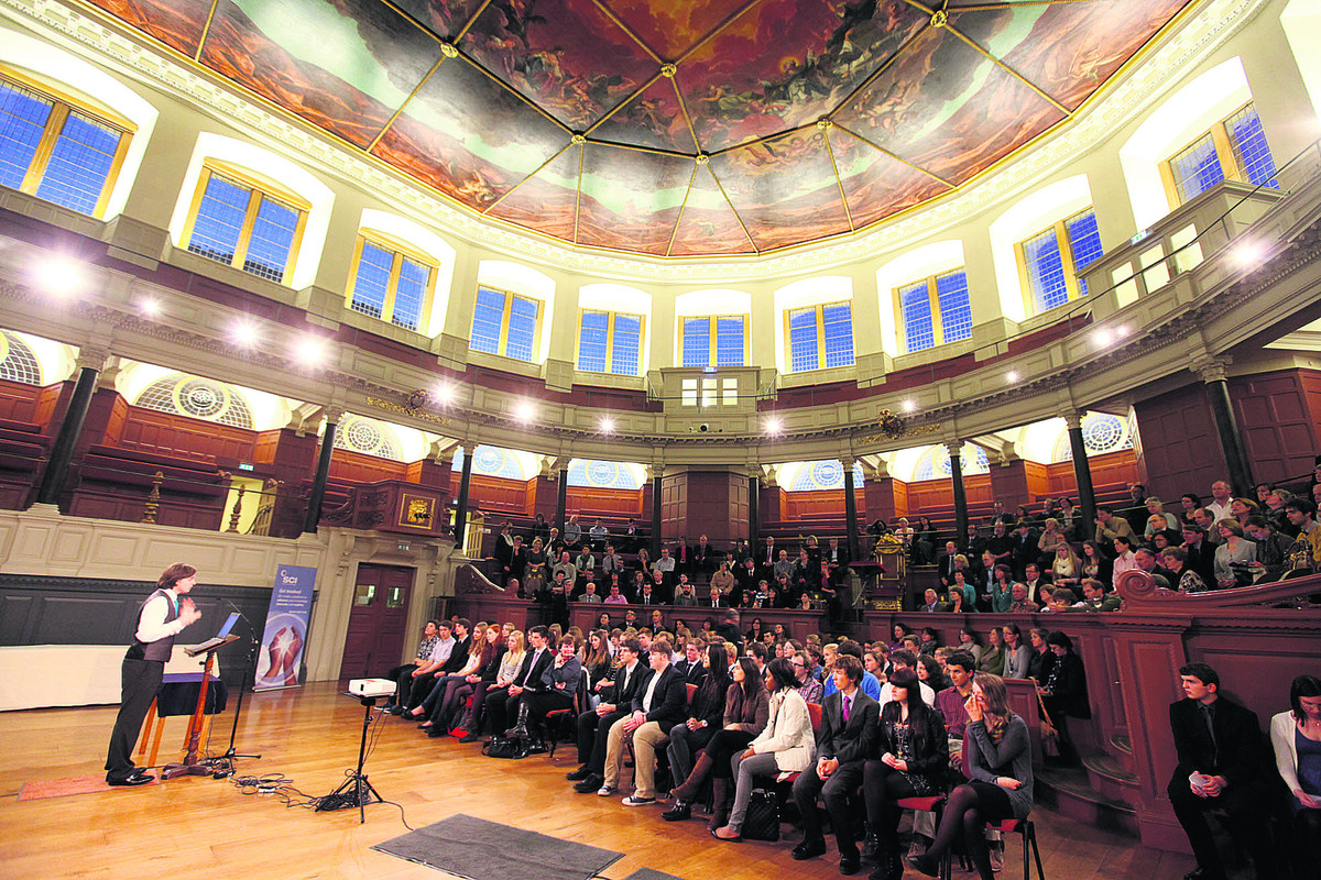 Organiser Brian Macken addresses the young scientists at the awards ceremony at the Sheldonian Theatre, Oxford