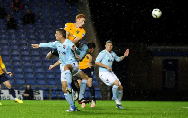 Oxford Mail: Dave Kitson heads for goal before his red card against Exeter