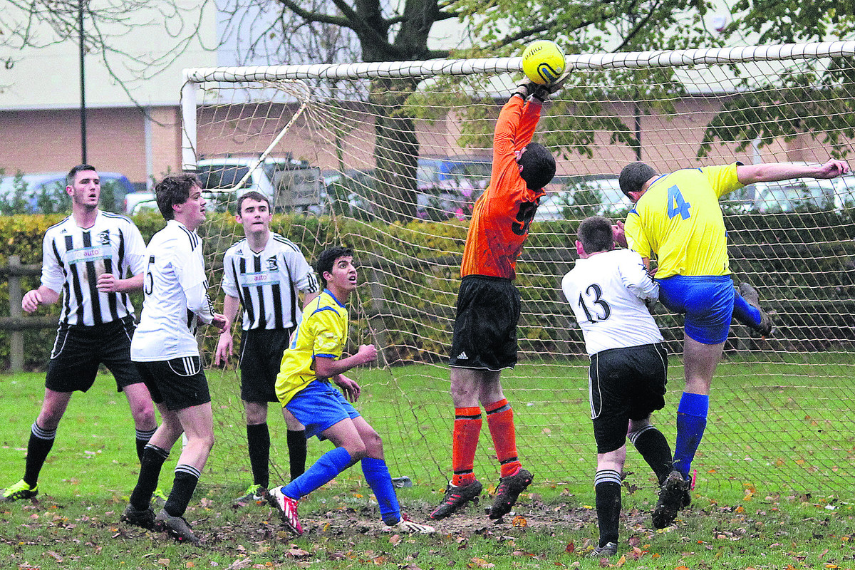 Kingham keeper Rob Collard drops a corner, which was bundled home by Jamie Tibbs (4) in Spartan Rangers' 3-0 home win
