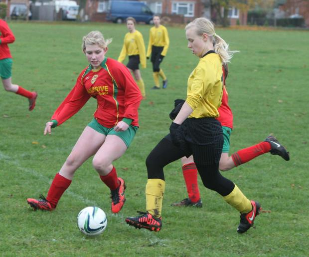 Oxford Mail: Alana Jones fires home for Benson United against Carterton in the Under 14 League