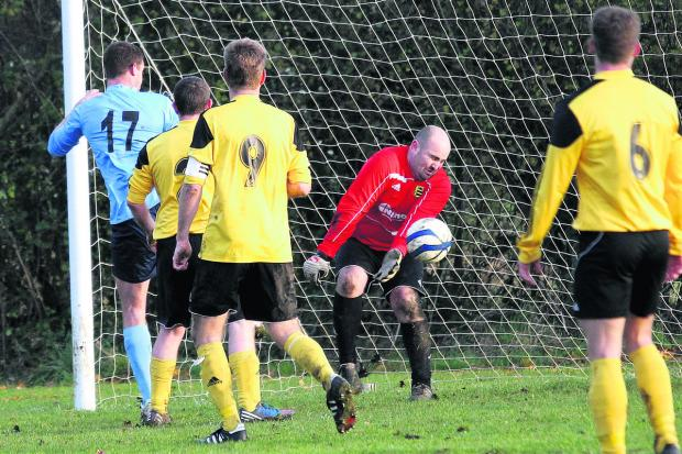 Chalgrove's Paul Coles (17) watches as his far post header beats Launton goalkeeper James Lisseter