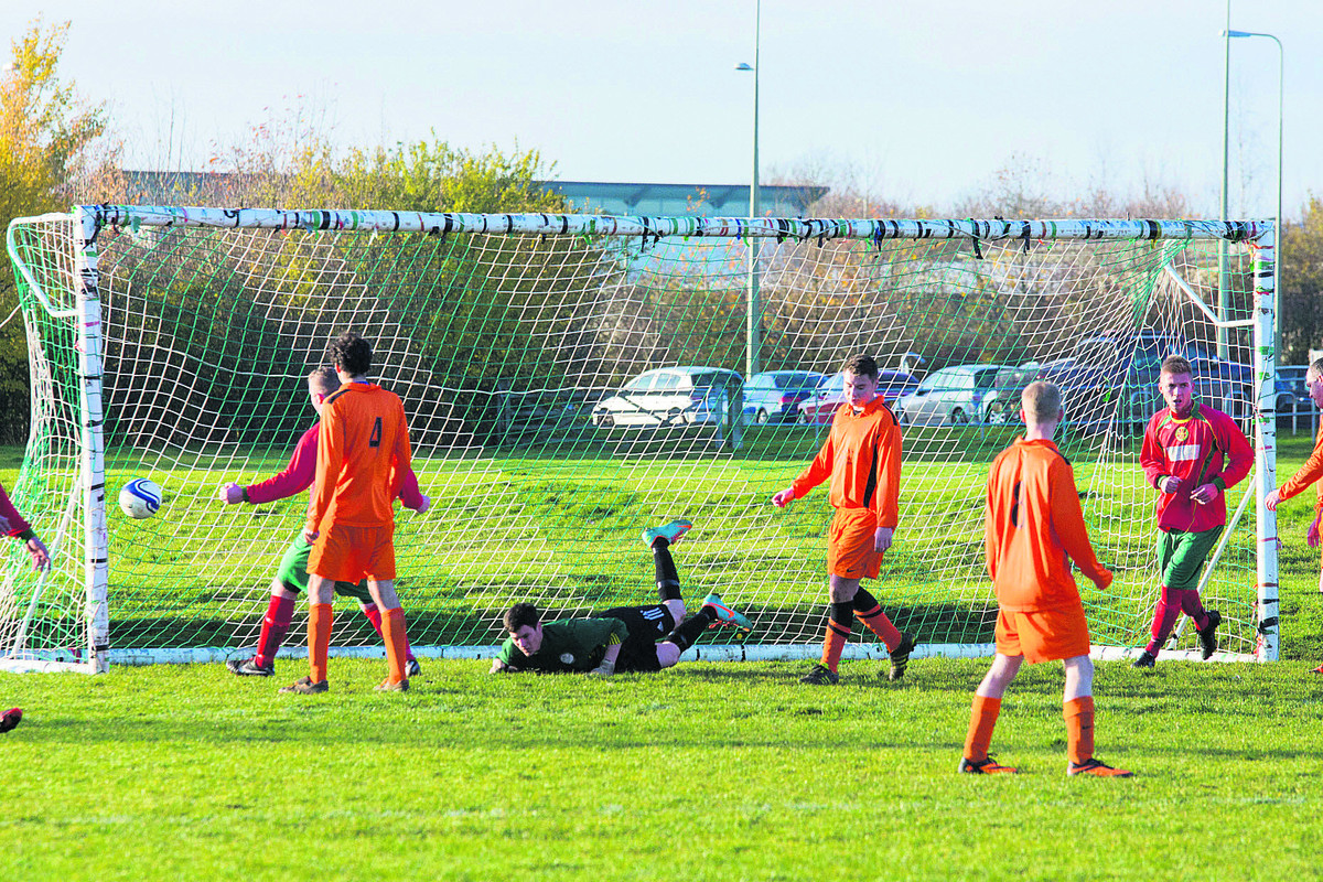 Jason Lonsdale (extreme right) heads off to celebrate after Carterton Town A set up a 2-1 victory against Minister Lovell