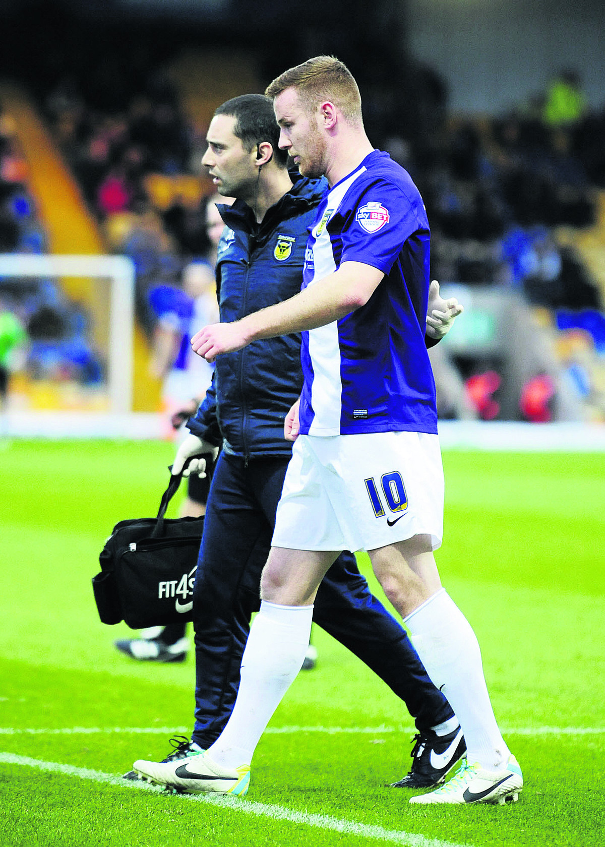 Deane Smalley limps off at Mansfield. The striker made his comeback against Gateshead on Thursday, but will be involved against Wrexham on Monday without being fully fit