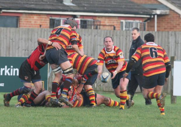Bicester scrum half Steve Risbridger passes to flanker Niall Morrow (6) during their 36-8 victory over Chipping Norton