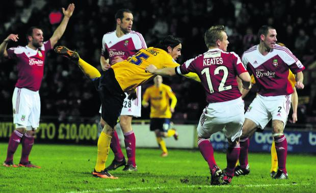 Oxford Mail: Ryan Williams nips in to head home Oxford United's winning goal at Wrexham last night