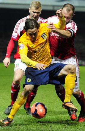 Ryan Williams takes on two defenders at Wrexham