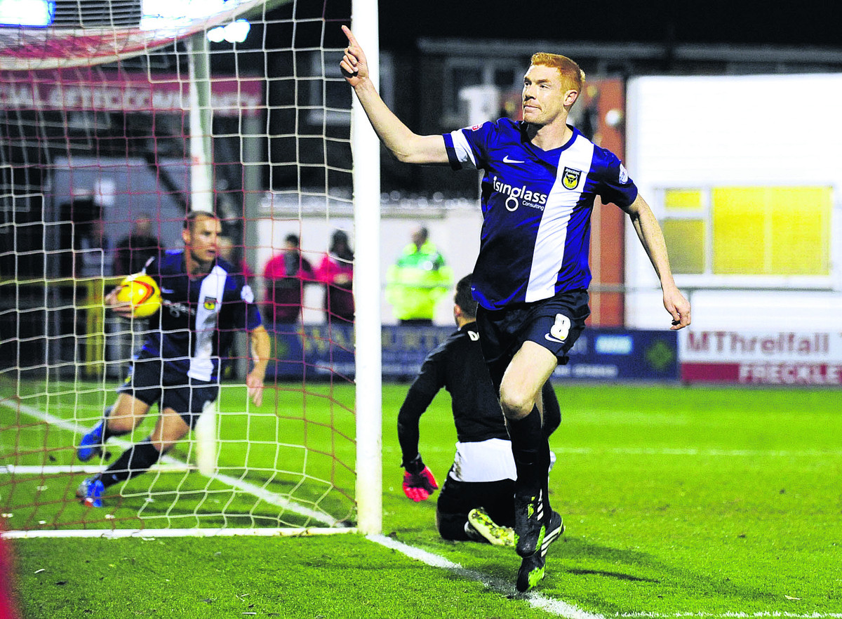 Dave Kitson celebrates in front of the Oxford United supporters after scoring at Fleetwood Town