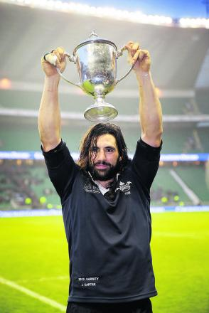 Oxford University captain John Carter raises the  cup in triumphant after his side's success at Twickenham