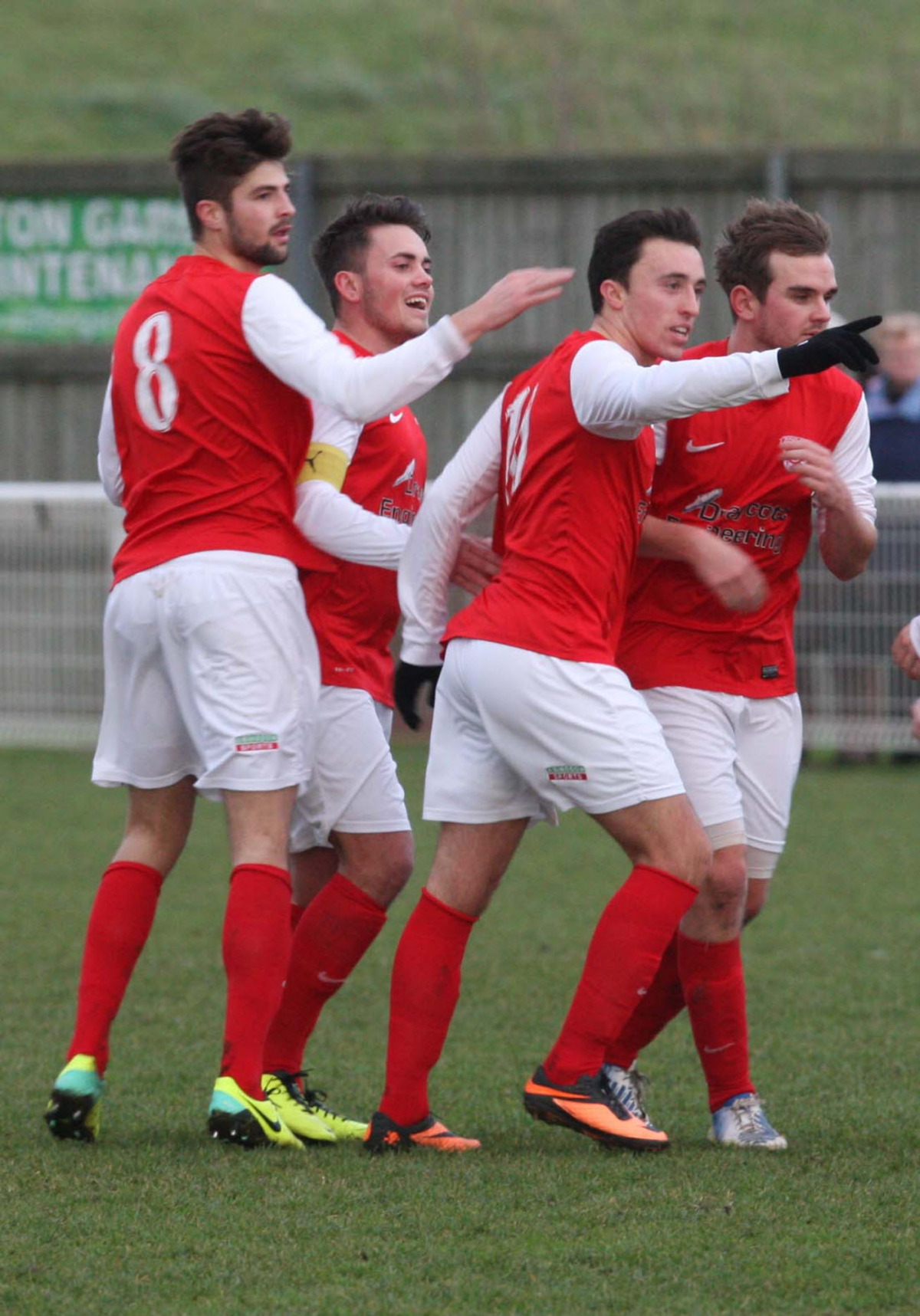 Ben Whitehead (second right) celebrates scoring Didcot Town's first goal