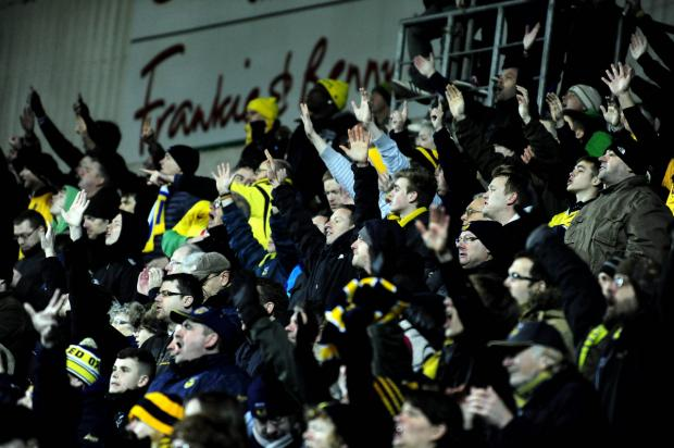 Oxford Mail: United fans get behind the team during Saturday's 2-1 win over Dagenham & Redbridge. Attendances are down on last year, but chairman Ian Lenagan hopes gates will improve if the U's continue their fine run
