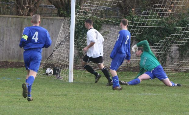 Oxford Mail: Will Morris (7) puts Eynsham ahead against Charlton United after just 69 seconds