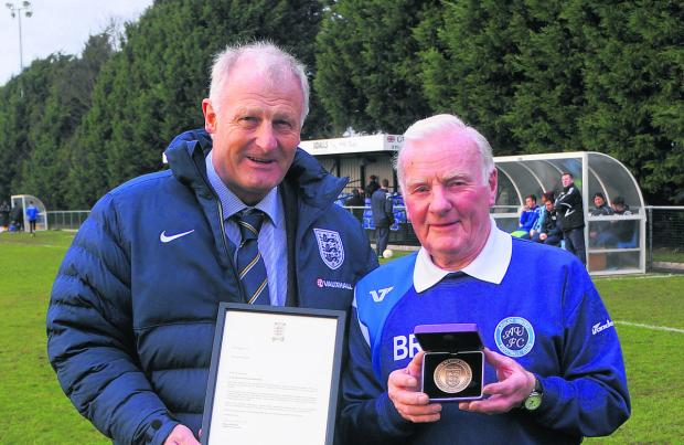 Ardley United assistant boss Brian Robinson (right) presented with his award by FA representative David Tutton