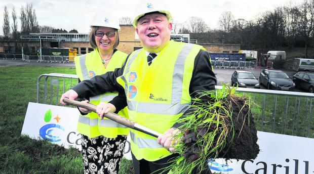 Brenda Mullen, chief executive of MacIntyre Academies, and council leader Ian Hudspeth break the ground for the new academy