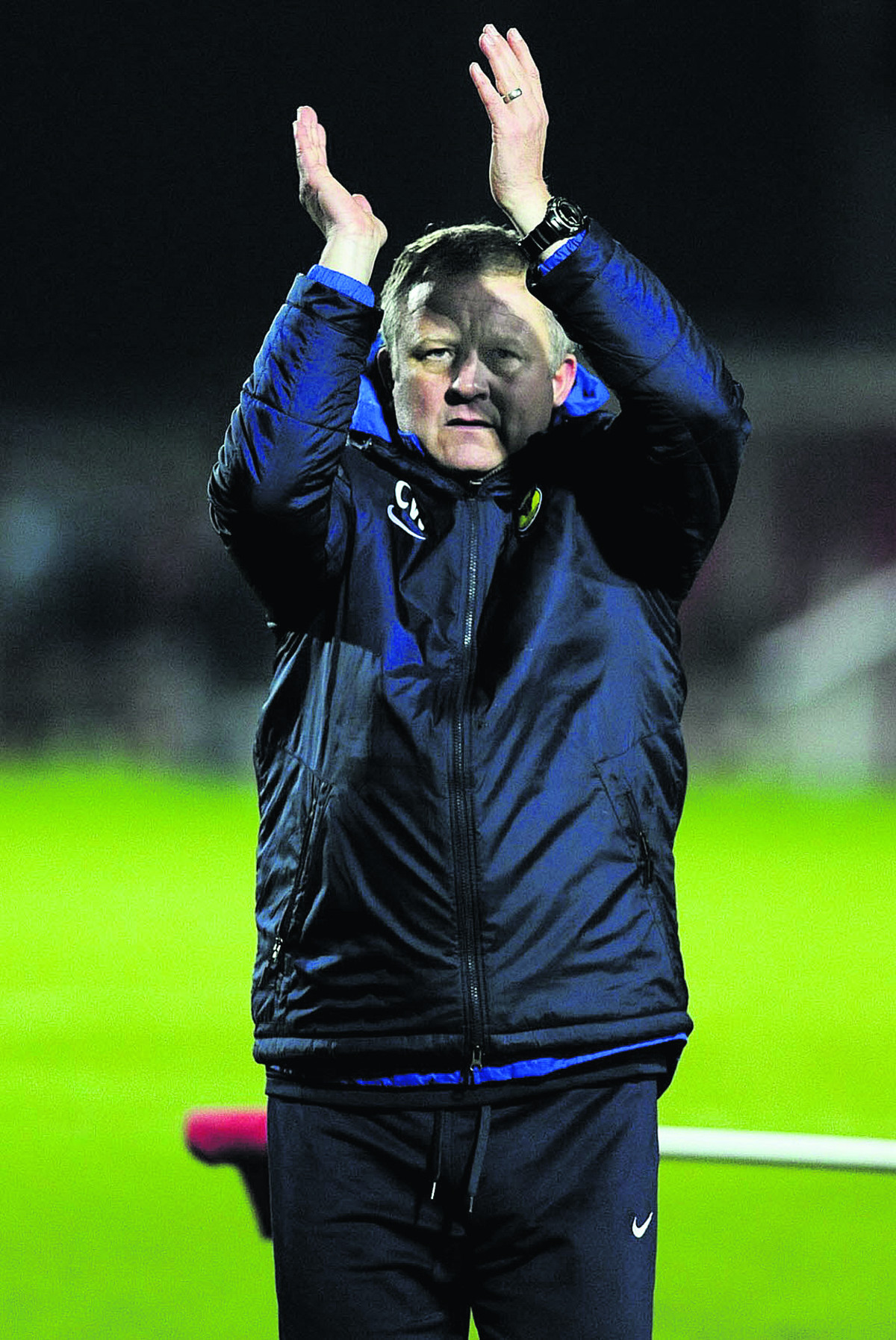 Chris Wilder acknowledges the Oxford United fans after the FA Cup win at Wrexham this month