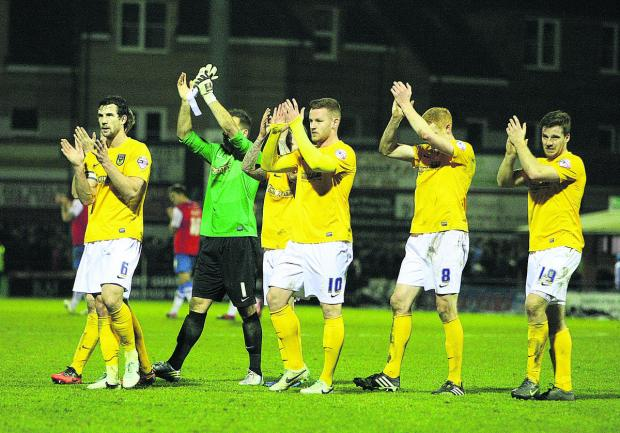 Oxford's players applaud the 455 travelling fans at York on Saturday after extending their unbeaten away run to ten matches with a 0-0 draw