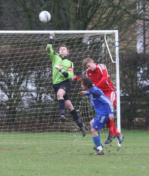Oxford Mail: Witney Royals goalkeeper Tom Such makes this clearance, but couldn't stop his side slipping to a 7-2 defeat at the hands of Hanborough