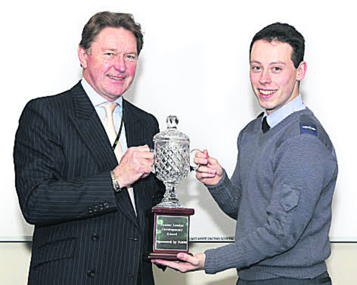Richard Thornley presenting the trophy to LAC Matthew Salt