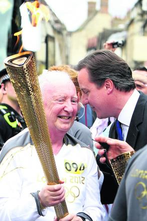 Clive Stone talking to David Cameron when he carried the Olympic Torch in 2012