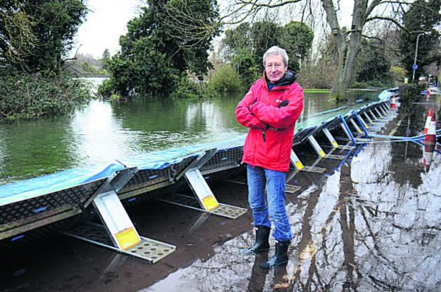 Oxford Mail: Bob Price at the flood defences.  Picture: OX64523 Marc West