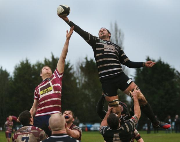 Liam Gilbert wins a line-out against Shelford