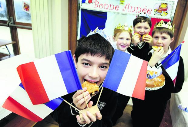From left, Adam Suardi, nine, Penny Hodgson, 10, Giuliano Page, 10, and Barnaby Hindley, eight, enjoying French cakes and pastries at the school's Galettes des Rois day Picture: OX64527 David Fleming