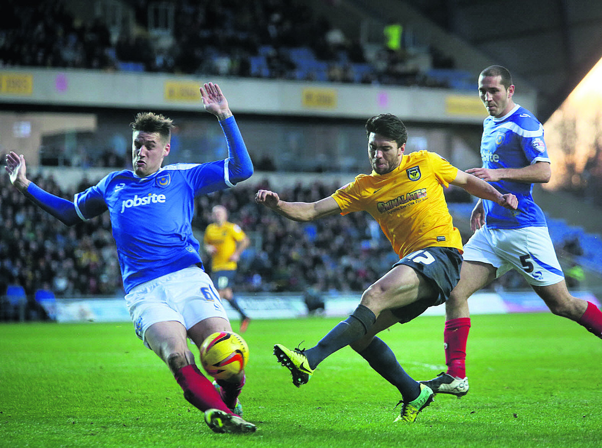 Danny Rose's effort is blocked by Portsmouth's Sonny Bradley