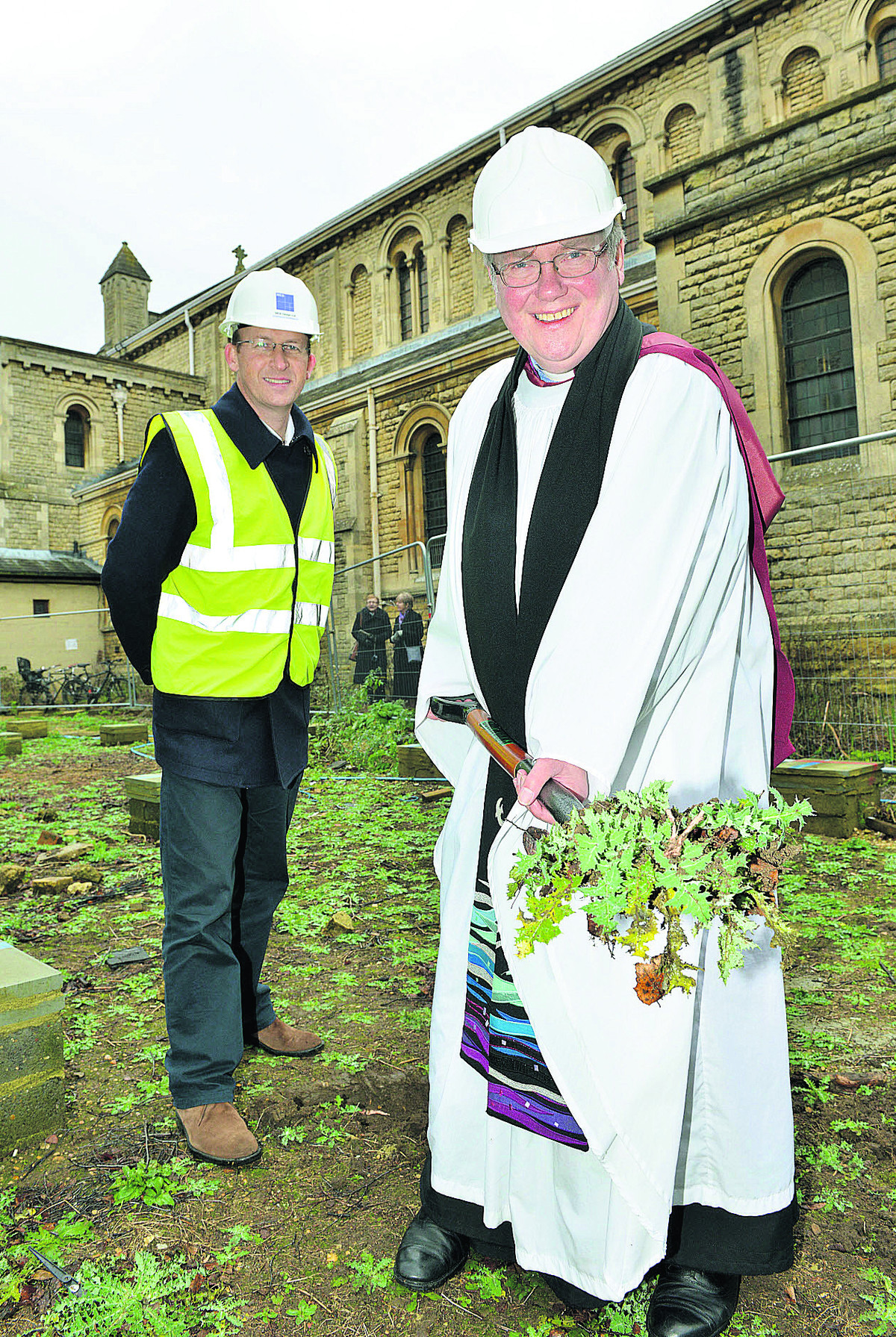Charles Darby, director of MEB Designs, oversees The Very Rev Robert Key, digging the first turf at St Andrew's
