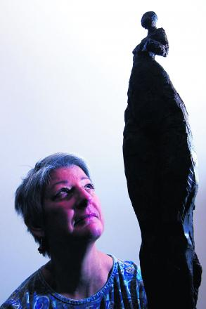 Pam Foley with one of her sculptures