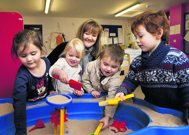 Oxford Mail: Playgroup manager Sandra Hardy with Poppy Hagan, Poppy Luxton, Reuben Lomax-Aspden and Emile Mathias. Picture: OX64615 Antony Moore