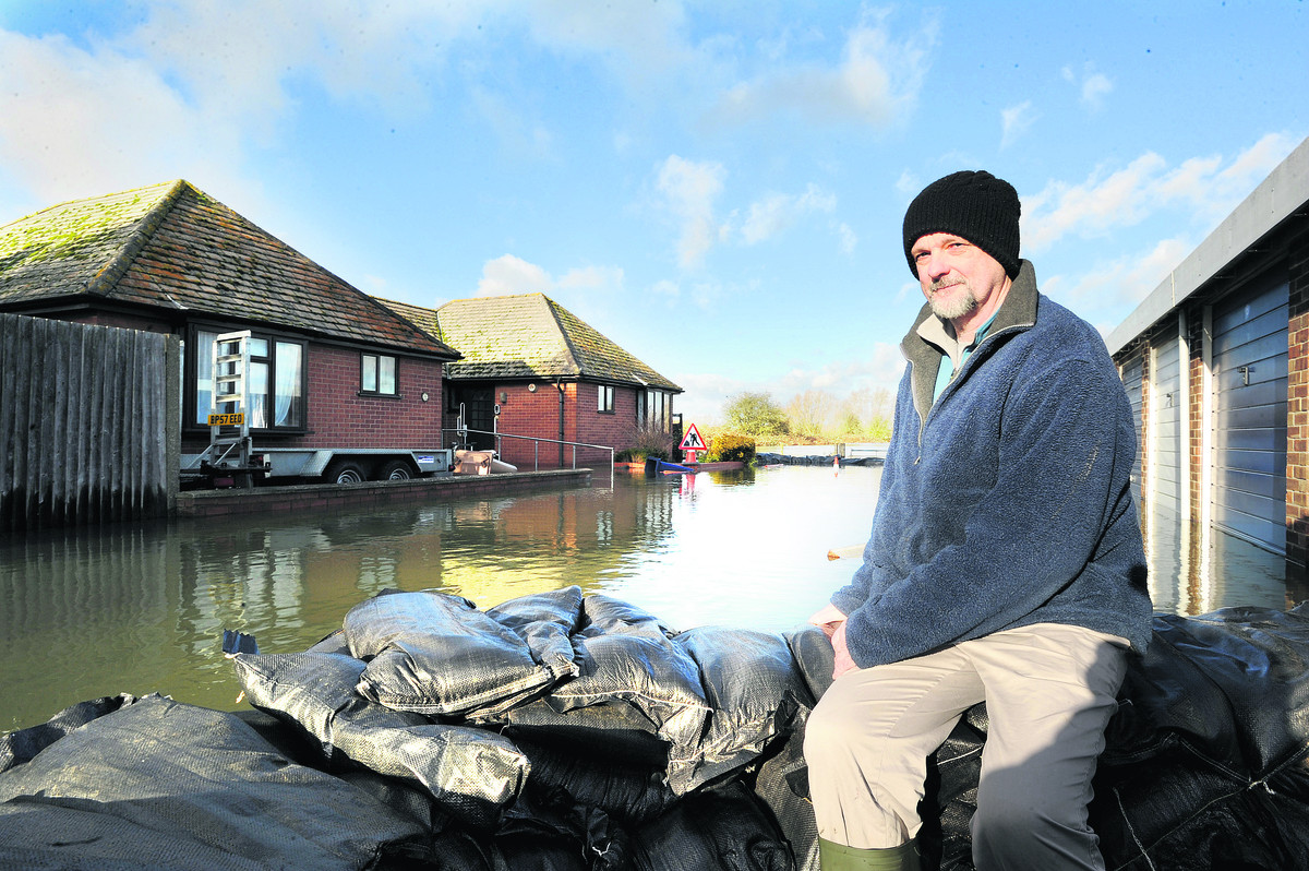 Gerrit Groenwold surveying his bungalow during last winter's floods in Bullstake Close off Botley Road, West Oxford.