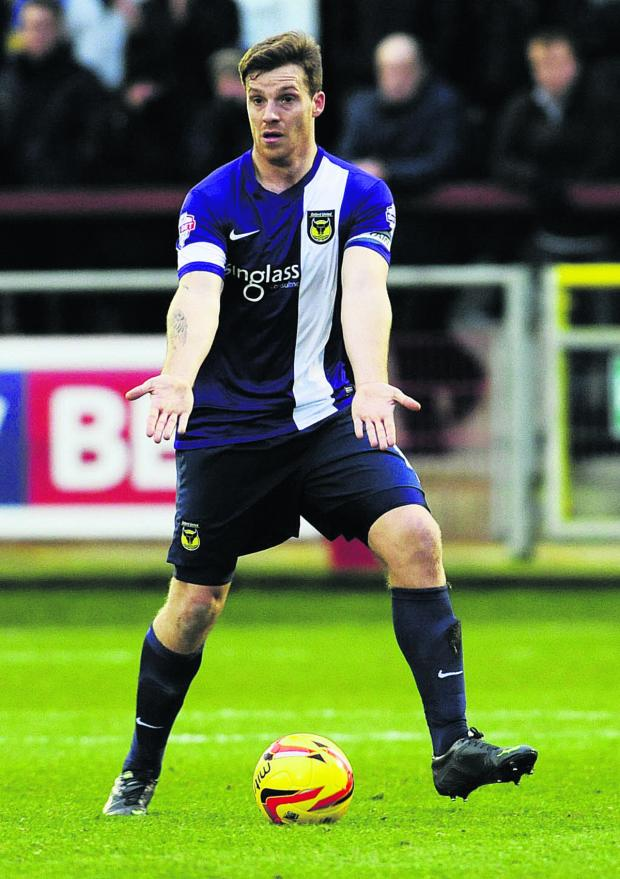 Oxford Mail: Johnny Mullins has impressed in a new midfield role during the last two games