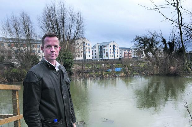 Nick Boles with the Castle Mill buildings in the background