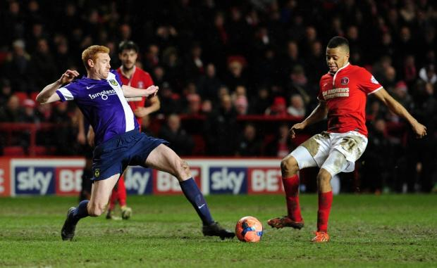 Oxford Mail: Dave KItson, pictured straining to reach the ball in Tuesday's 2-2 draw at Charlton Athletic in the third round of the FA Cup, thinks Oxford United would benefit from two new signings