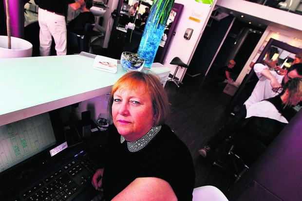 Oxford Mail: Manager Shirley Popham at Popham hair salon in North Parade, Oxford, which suffered a cyber attack last May. Picture: OX59660 Ed Nix