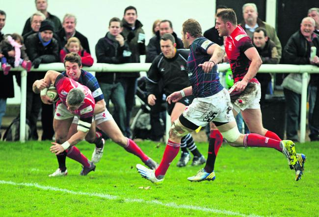 Skipper Tom May forces his way over for London Welsh's first try